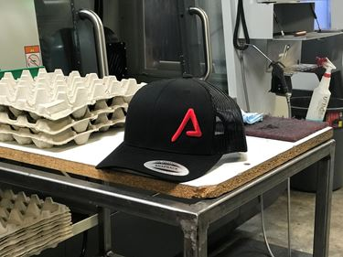 Picture of Agency Arms Embossed Logo Retro Trucker Hat